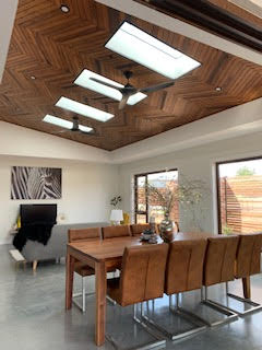 Dining area following mainly wooden theme and glass wall on one side, allowing maximum natural light.